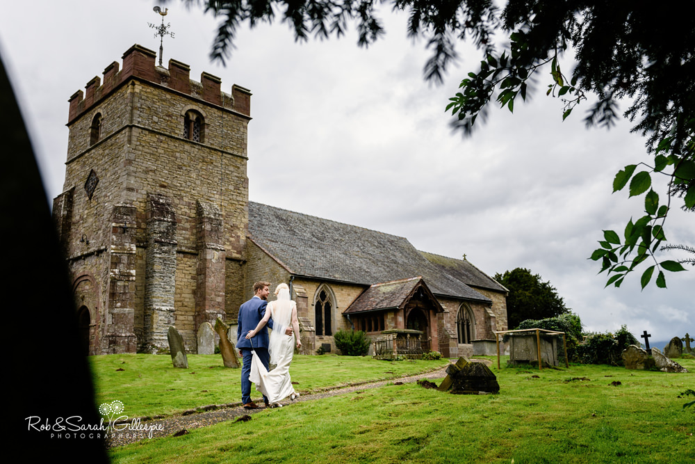 Bride and groom together outside St Peter's Church Diddlebury