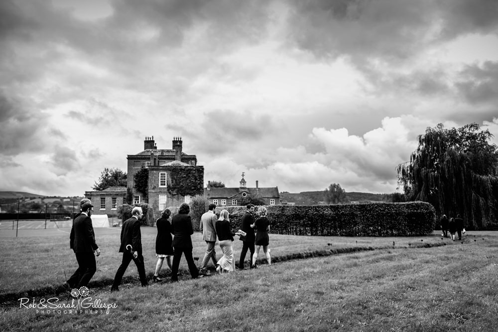 Wedding guests walk to Delbury Hall