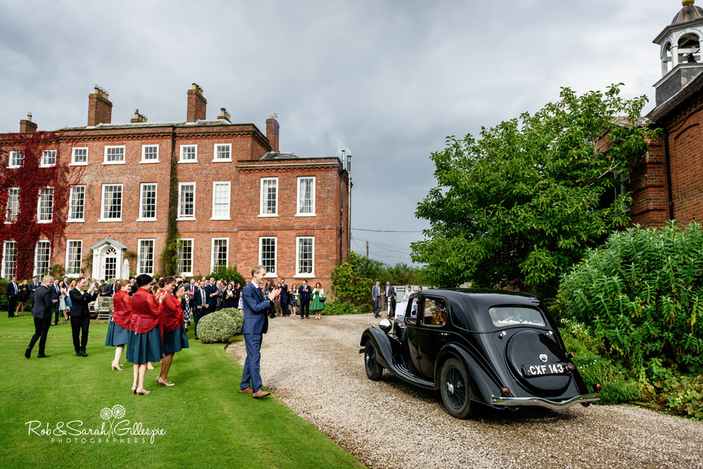 Wedding car arrives at Delbury Hall