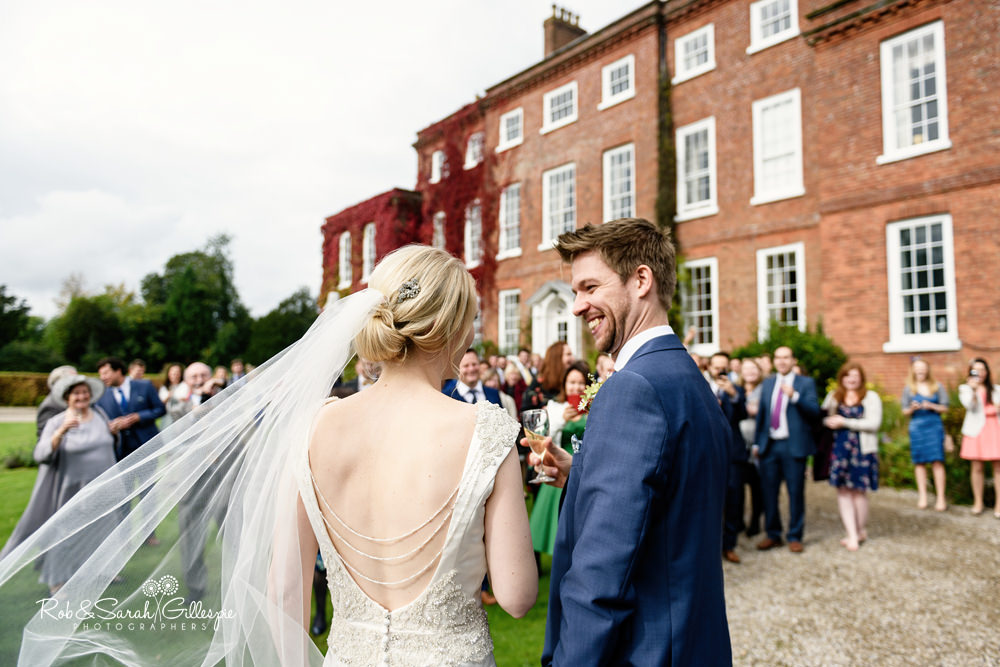Bride and groom greeted by guests at Delbury Hall wedding