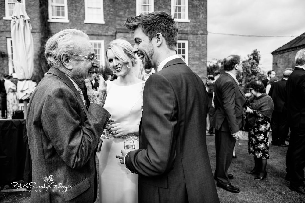 Wedding guests enjoying drinks reception at Delbury Hall wedding