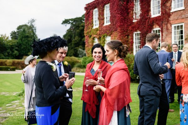 Wedding guests chat at Delbury Hall