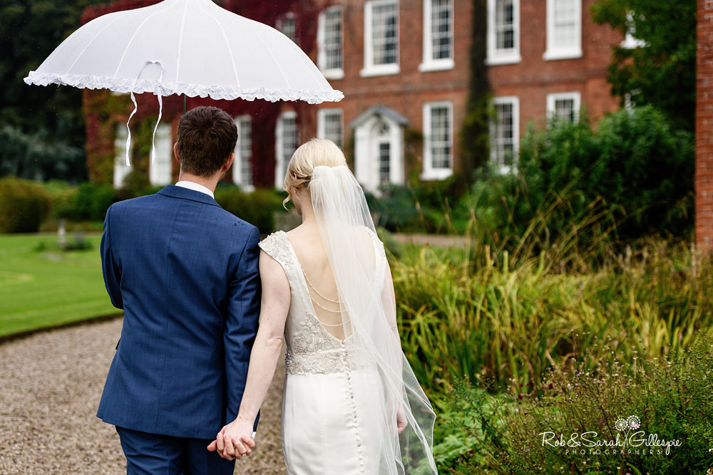 Bride and groom together in grounds of Delbury Hall