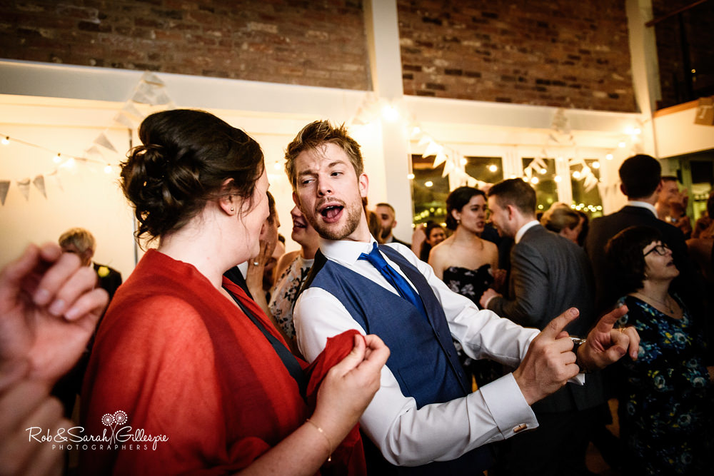 Dancing at Delbury Hall Coach House wedding