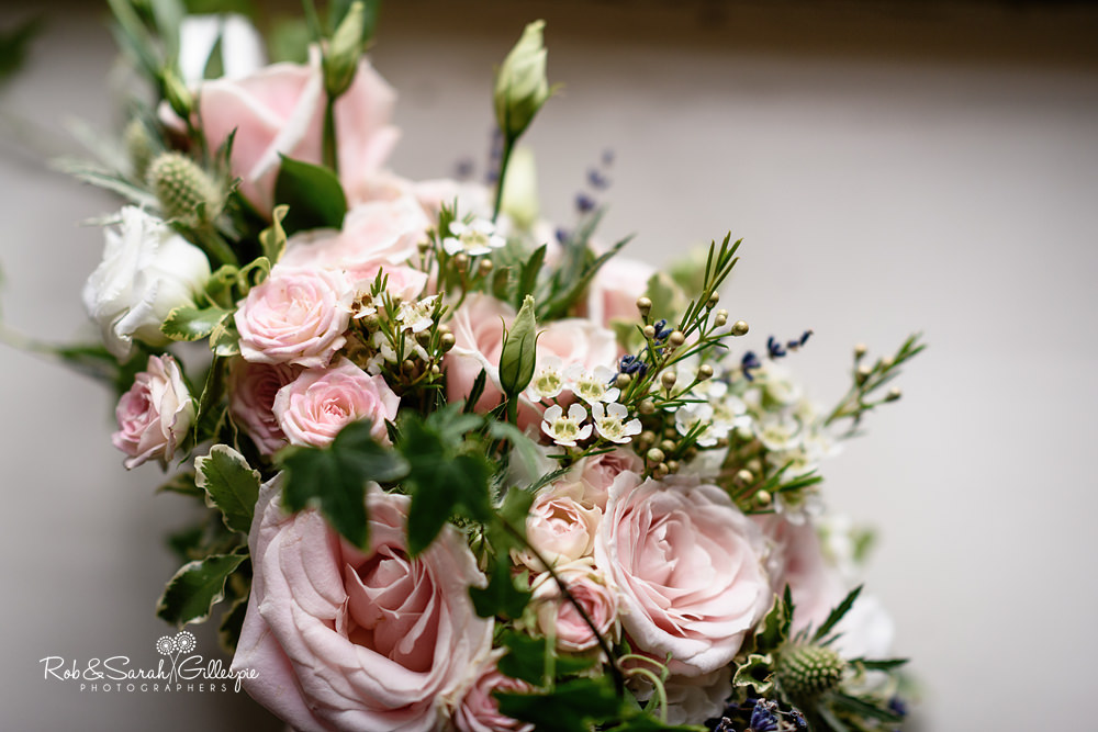 Beautiful bridal flowers in window light at Eastnor Castle