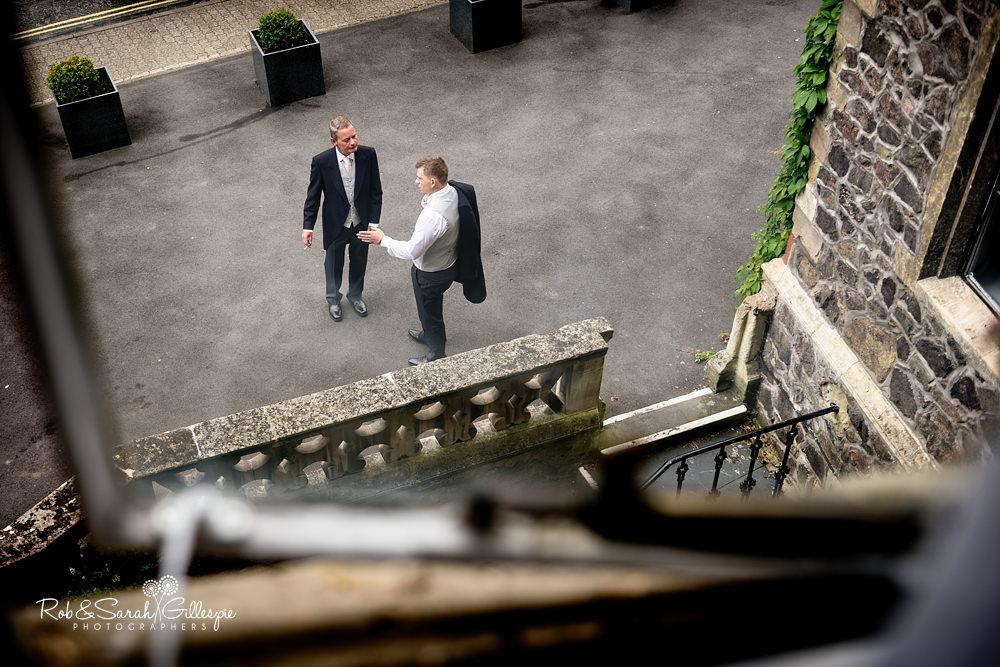 Groom getting at Abbey Hotel in Malvern for wedding at Malvern College