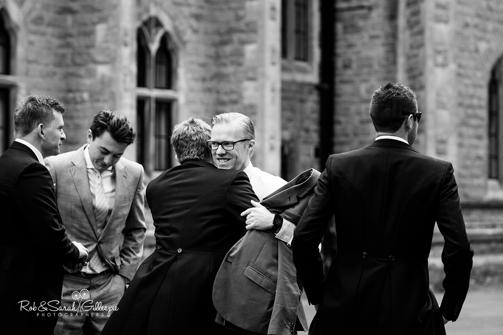 Groom greeting friend at Malvern College