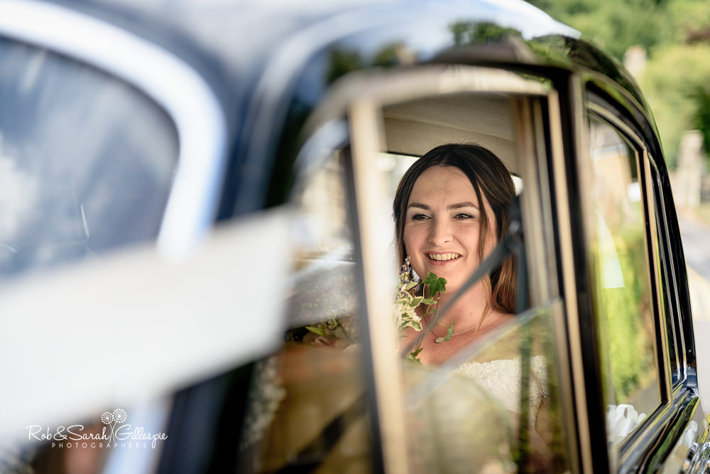 Bride's car arrives at Malvern College chapel