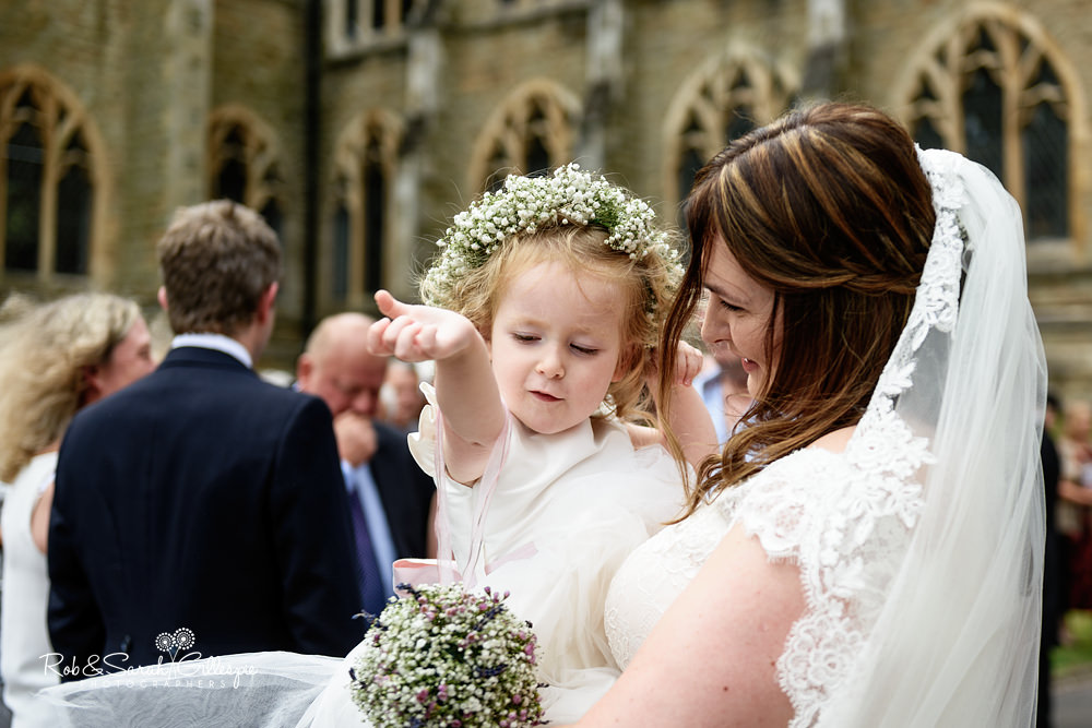 Wedding guests throw confetti and congratulate bride and groom at Malvern College