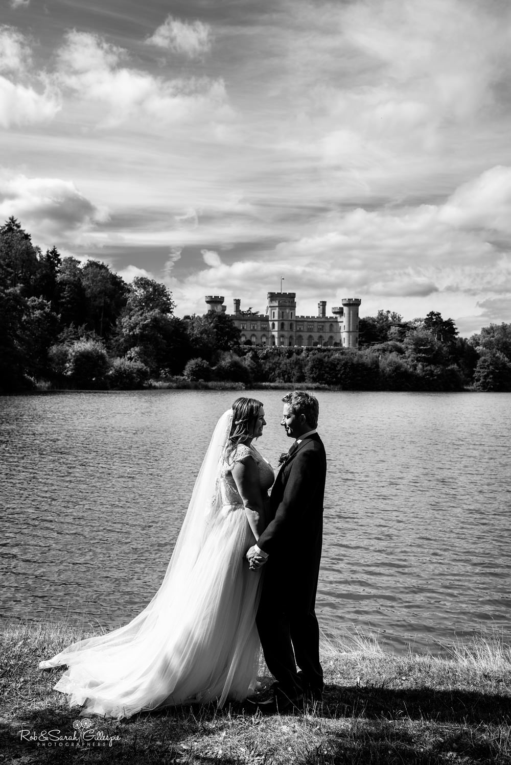Bride and groom together on stairway at Eastnor Castle