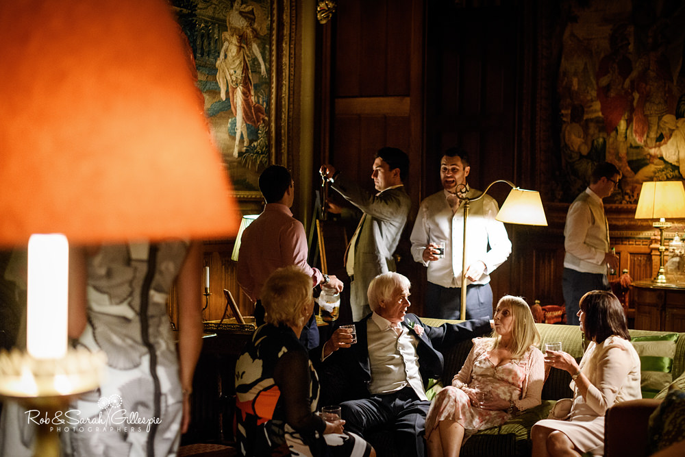 Guests enjoy wedding party at Eastnor Castle