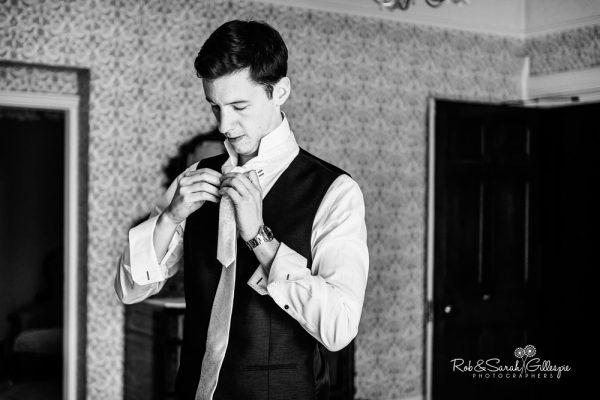 Groom prepares for wedding at Highbury Hall