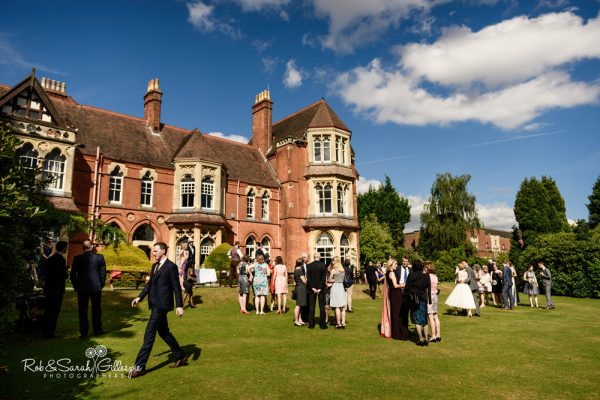 Wedding guests relaxed in grounds at Highbury Hall