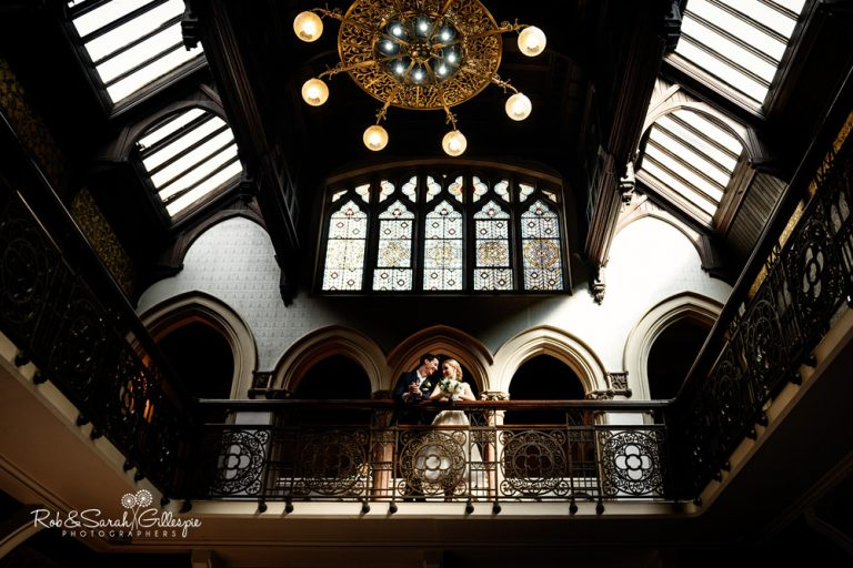 Bride and groom on balcony at Highbury Hall