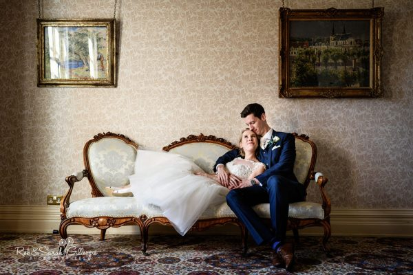 Bride and groom on couch at Higbbury Hall