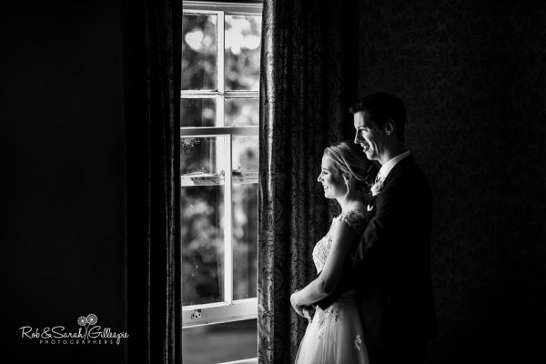 Bride and groom in window light at Highbury Hall