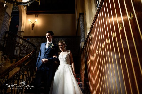 Bride and groom on staircase at Highbury Hall