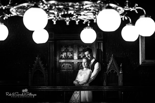 Bride and groom at Highbury Hall with ceiling lights