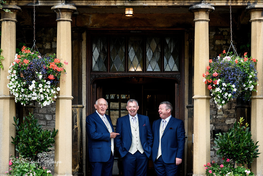 Groom and friends posing for photo at Castle Hotel in Taunton