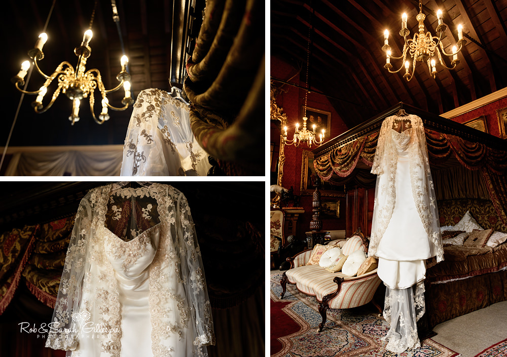 Wedding dress hanging from four-poster bed at Maunsel House