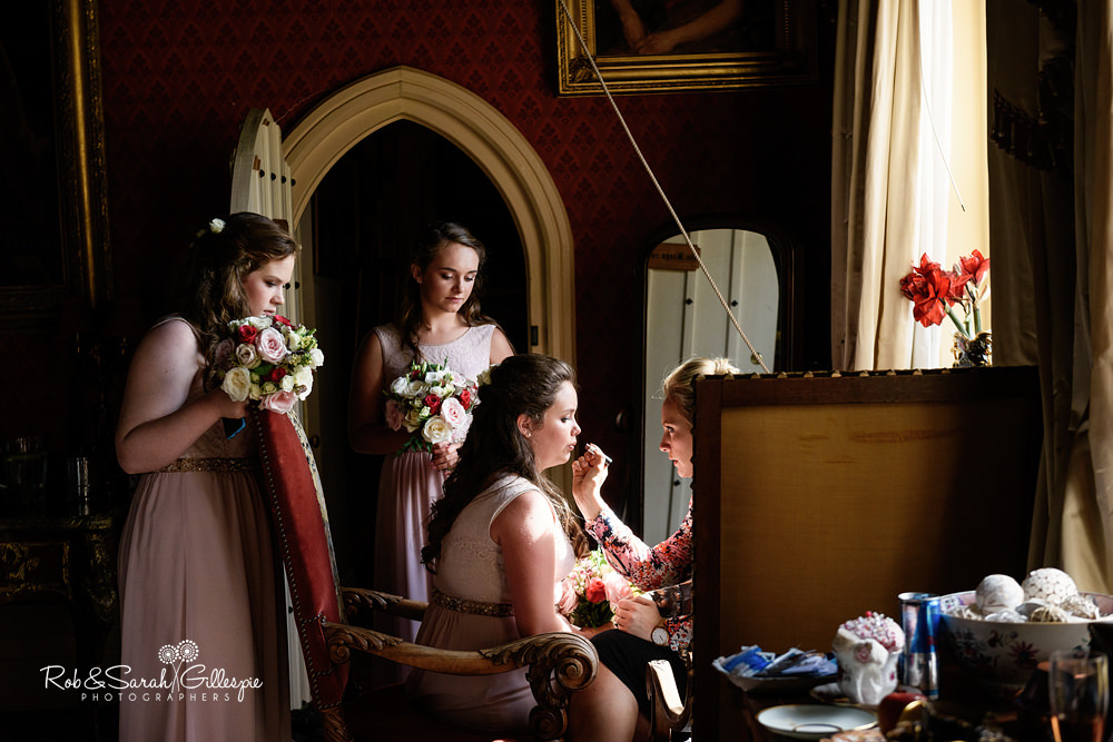 Bridesmaid has makeup applied at Maunsel House
