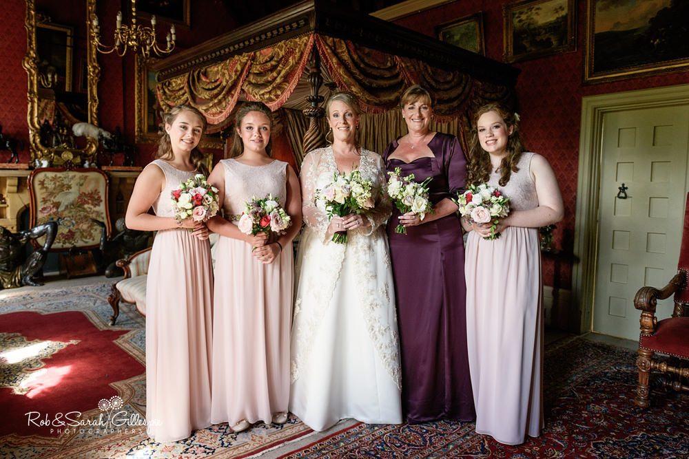 Bride and bridesmaids pose for photo in spectacular Maunsel House bedroom