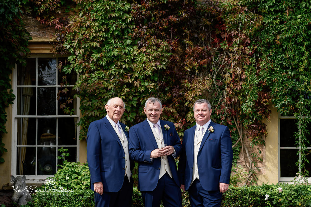 Groom and friends pose for photo at Maunsel House in Somerset