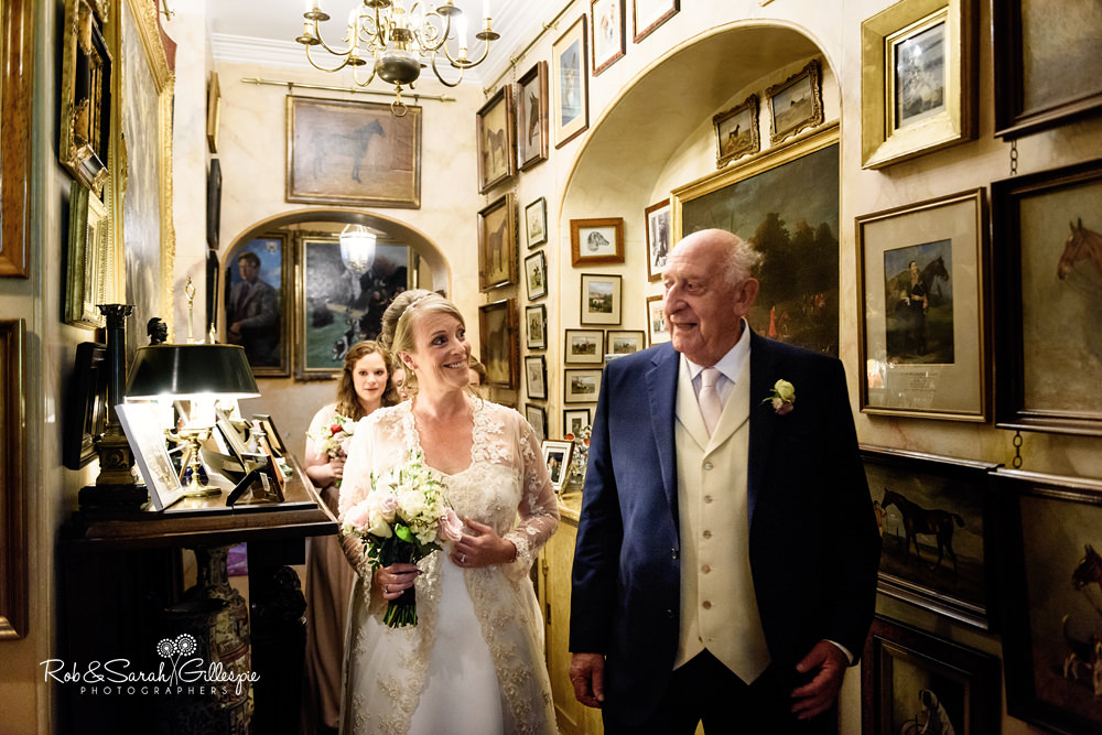 Bride walks through Maunsel House before wedding ceremony