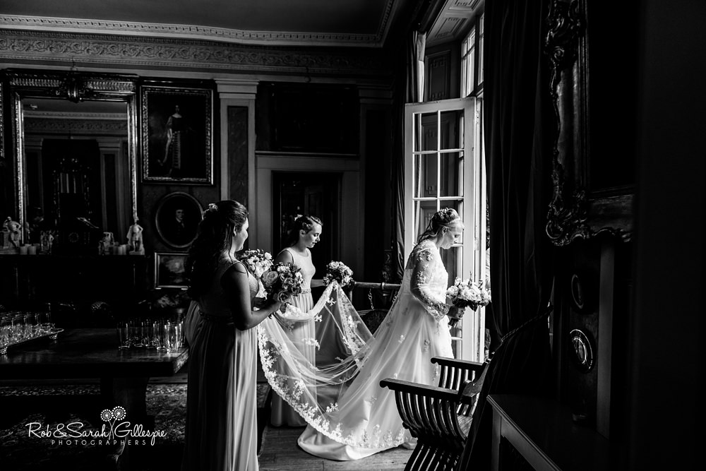 Bride and bridesmaids in beautiful light as they go outside for wedding ceremony