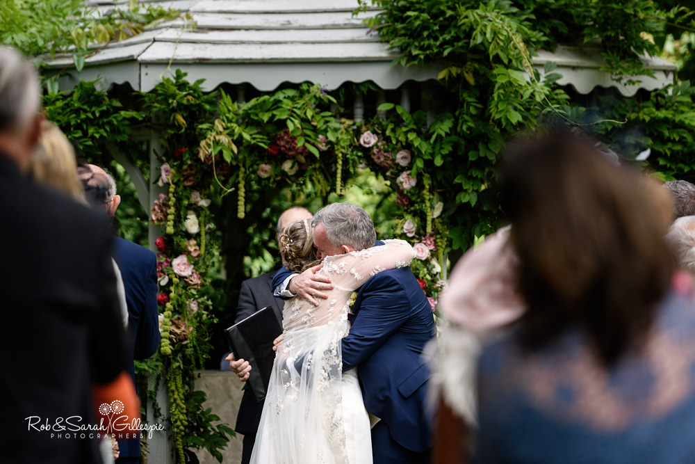 Outdoor wedding ceremony in gardens at Maiunsel House in Somerset