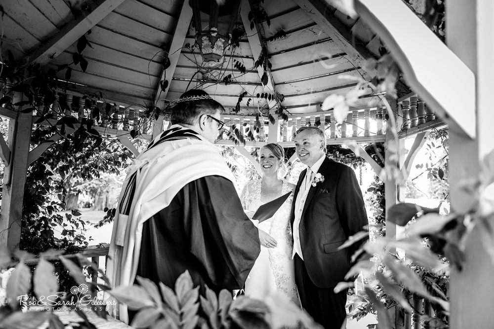 Jewish wedding blessing in gardnes at Maunsel House in Somerset