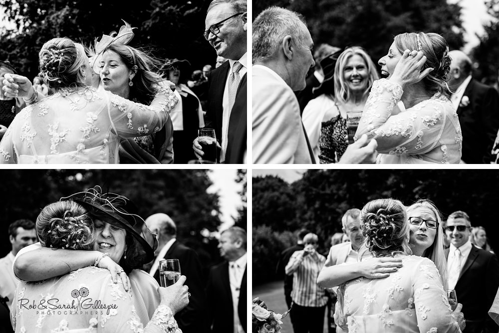 Wedding guests hug bride and groom after outdoor wedding at Maunsel House