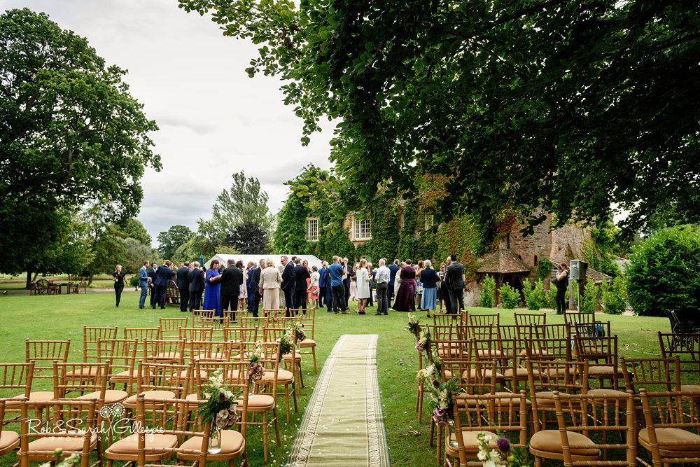 Wedding guests enjoy drinks reception after wedding at Maunsel House
