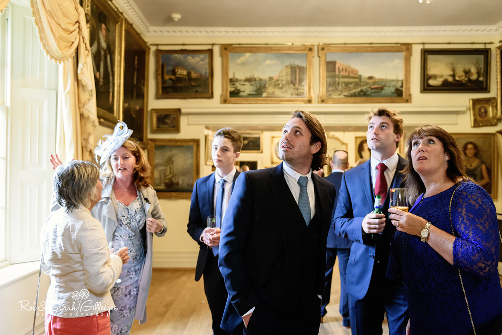 Wedding guests enjoying drinks reception at Maunsel House