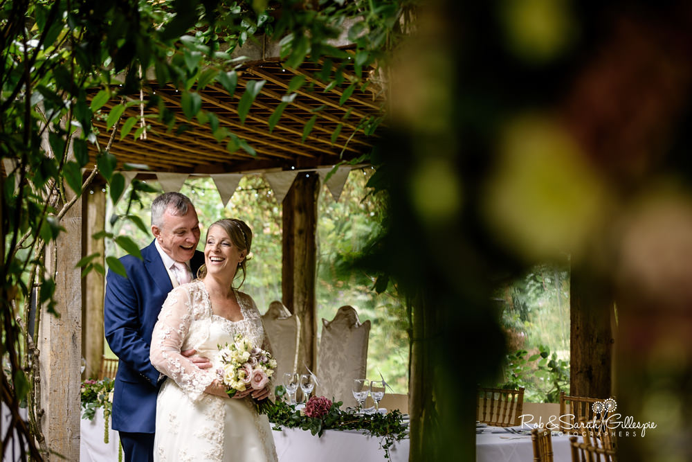 Bride and groom enjoying time alone under pergola at Maunsel House