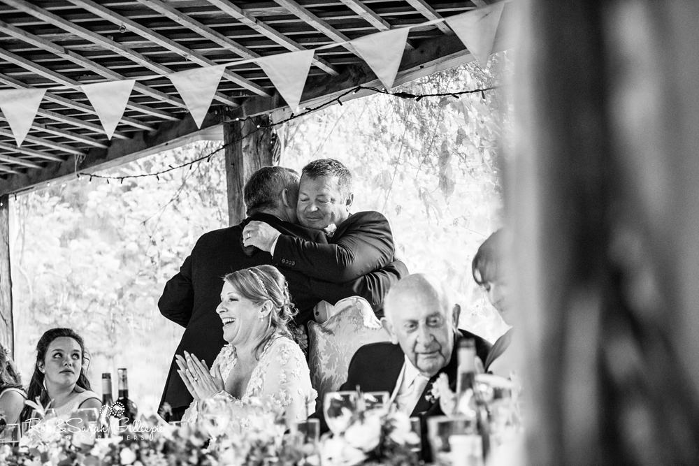 Wedding speeches under pergola at Maunsel House