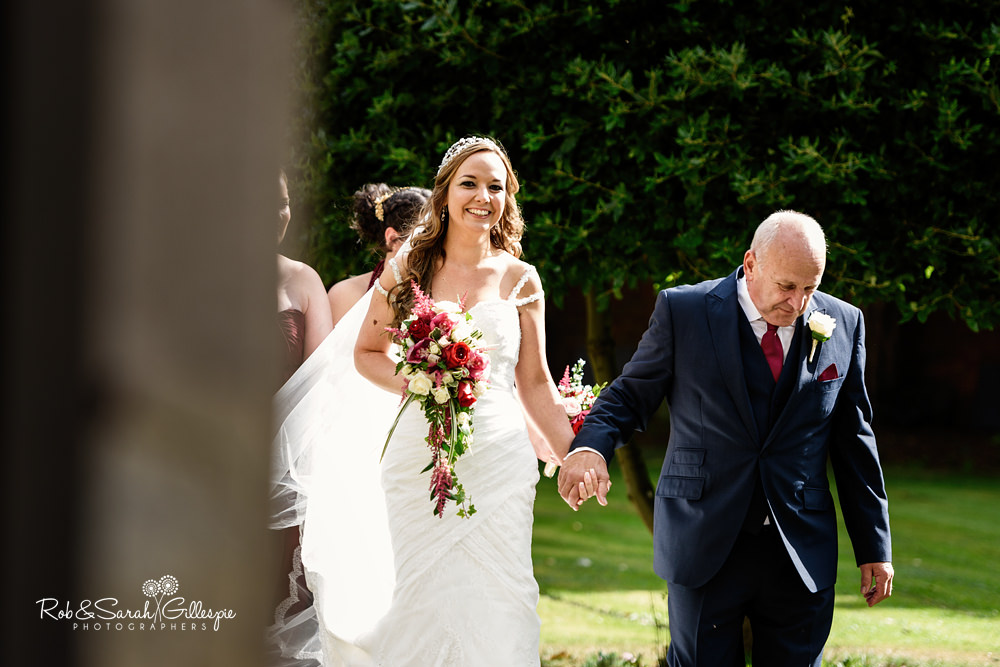 Bride arrives at All Saints church Grendon