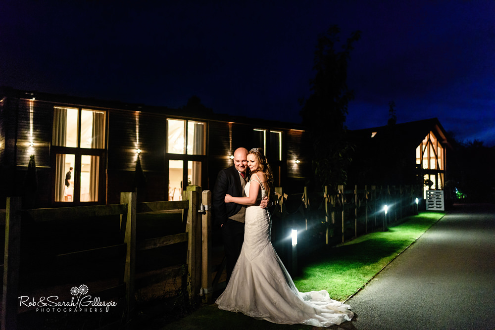 Bride and groom outside Mythe Barn at night