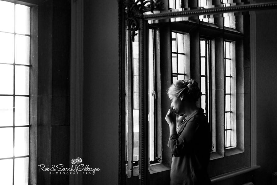 Bride listening to phone call while getting ready for wedding