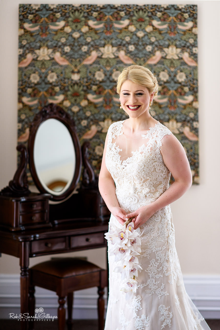 Portrait of bride smiling in bedroom at Pendrell Hall