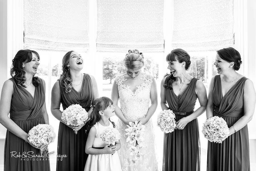 Bride and bridesmaids shae a joke before wedding at Pendrell Hall