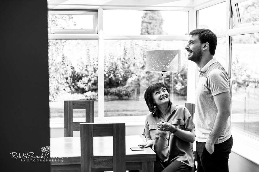 Groom and mum chatting in cottage at Pendrell Hall