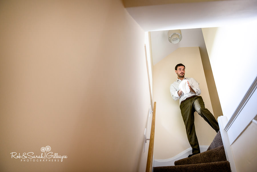 Groom on stairway at Pendrell Hall