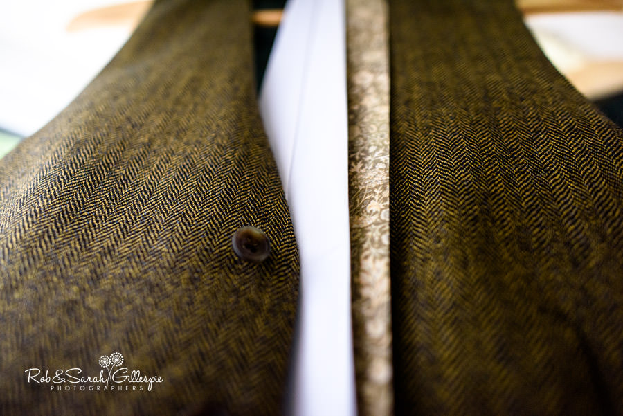 Close-up detail picture of groom's bespoke suit