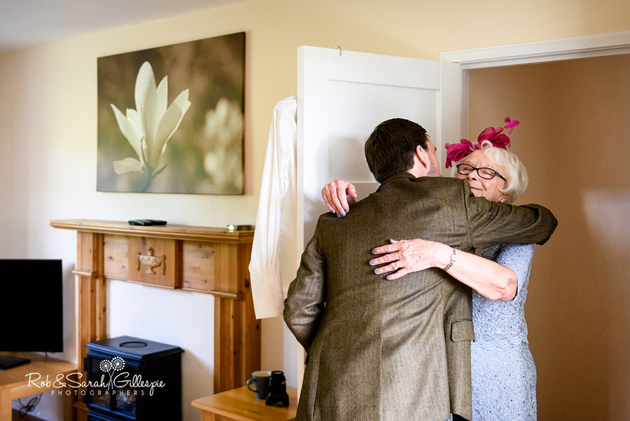 Groom hugs grandmother in door at Pendrell Hall cottage