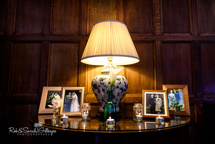 Candles and old family wedding photos on display at Pendrell Hall