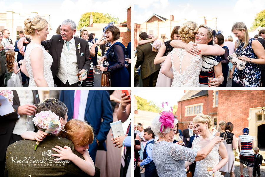 Wedding guests congratulate and hug couple
