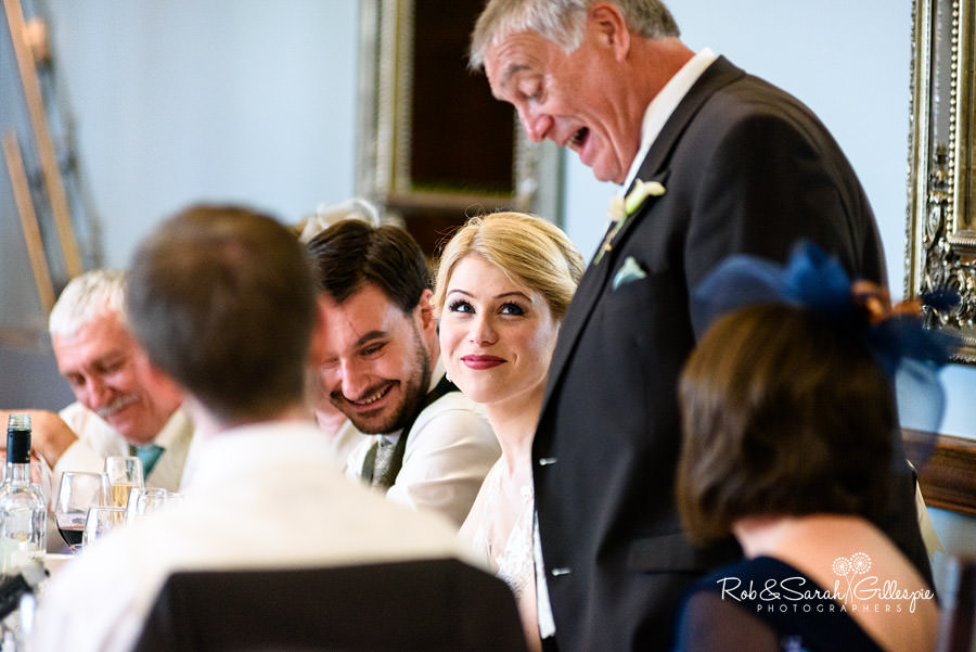 Bride smiles at dad during speeches