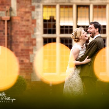 Bride and groom laughing together at Pendrell Hall in Staffordshire
