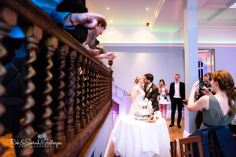 Bride and groom cut wedding cake at Pendrell Hall